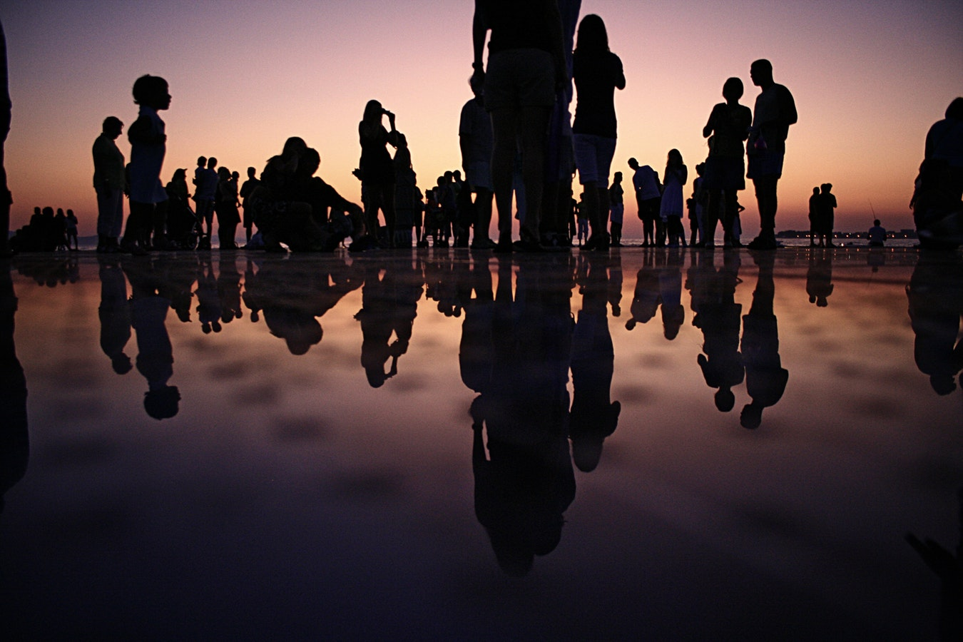 People standing on a mirror during golden hour. Everyone Isn't You