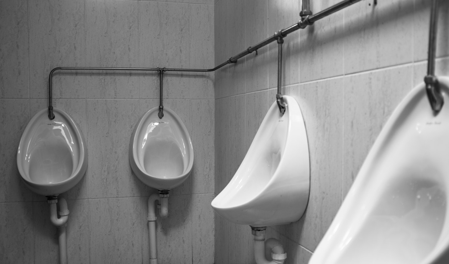 White urinals hanging on two walls