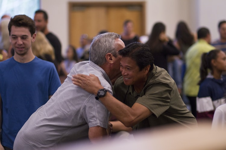 two men hugging at an event