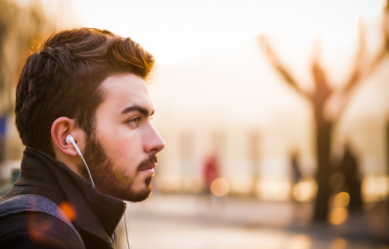 man with ear buds