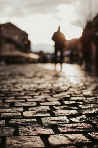 man on cobblestone path