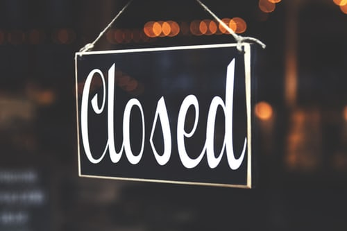 closed sign hanging on store door