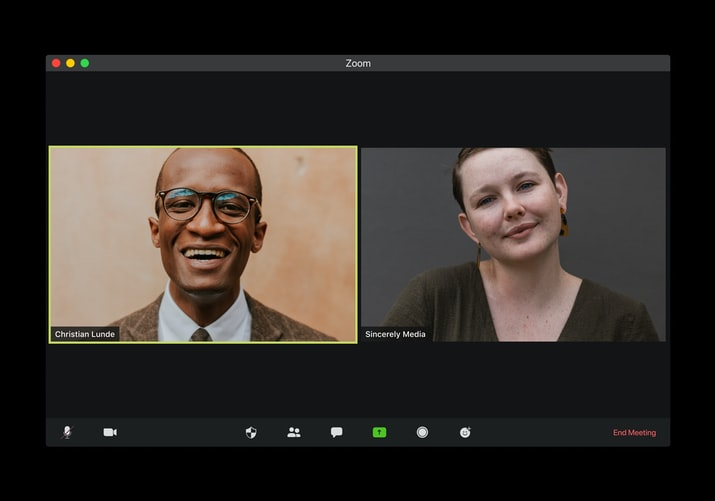 Man and woman on split screen in a Zoom meeting