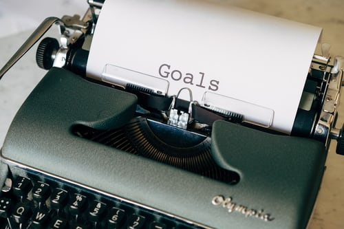 Olympia typrwriter with one word typed on paper -- Goals