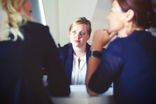 3 business women at a desk