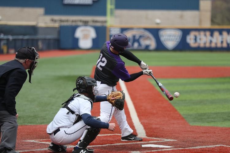 Batter at plate swing bat -- baseball
