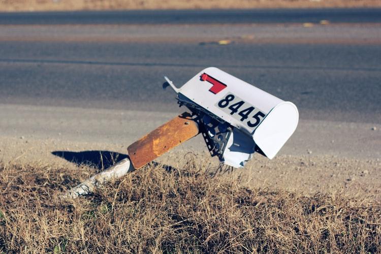 broken mailbox by roadside