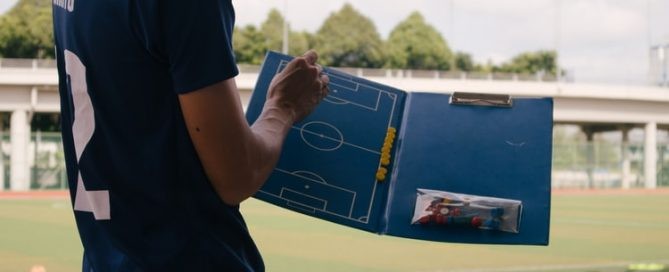 coach with clipboard