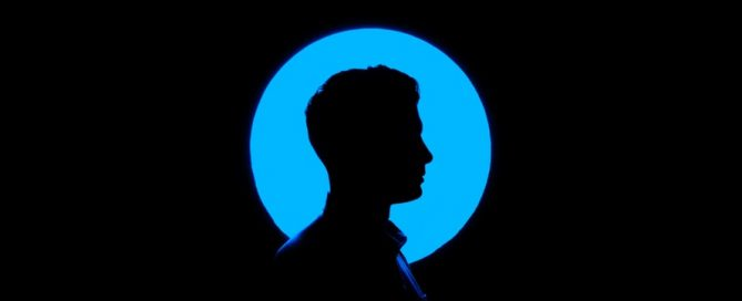silhouette of a man black on blue on black