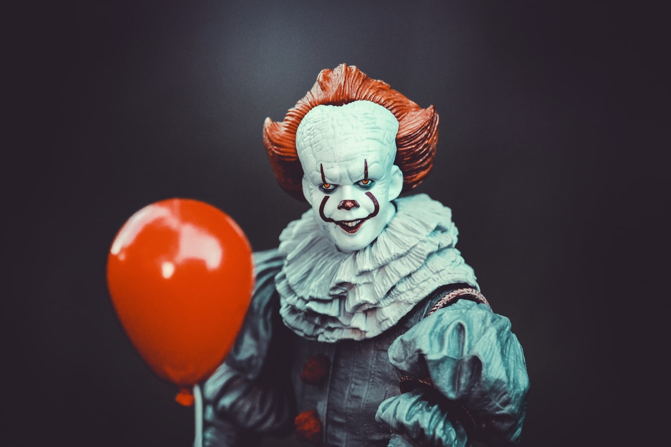 clown with red balloon