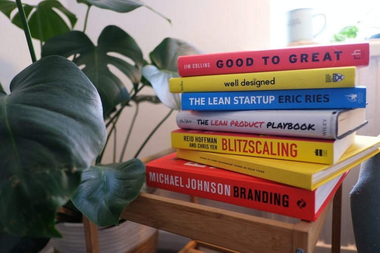 A stack of books about Management Style