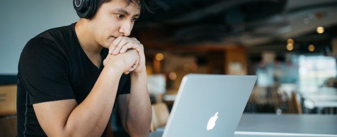Man at computer looking worried or upset